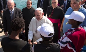Pope Francis greets immigrants during his visit to the island of Lampedusa.