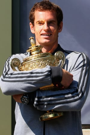 Not letting go of that in a hurry. Andy Murray poses with the Gentlemen's Singles Trophy next to the Fred Perry statue at Wimbledon.