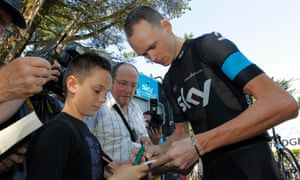 Race leader yellow jersey holder Team Sky rider Christopher Froome of Britain takes some time out on rest day of the Tour de France to sign some autographs in La Baule, France.