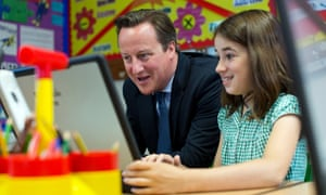 David Cameron sits with pupil Anna Seitoar, six, in a computer class at St Mary's and St John's CE School in north London. Education Secretary Michael Gove published details of the revised national curriculum today.