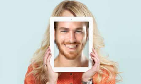 Woman holding iPad in front of face