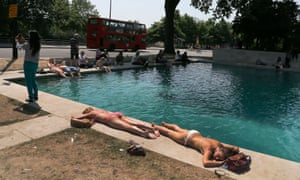 People enjoy the sun near a fountain at Hyde Park in London. The capital experienced the warmest days of the year with temperatures up to 29 celsius.
