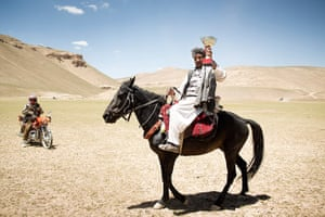 Silk Road Festival: The Buzkashi winner with his team's trophy, near Yakawlang, during the 5th