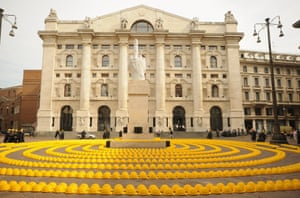 A general view of thousands of yellow helmets laid out as part of a protest during an event to address working laws within the construction industry, in front of the Milan stock exchange building in Milan, Italy. Italy's once prosperous construction industry has suffered as a result of the country's economic struggles over the past 5 years, with an estimated 800-900,000 jobs lost in that period.