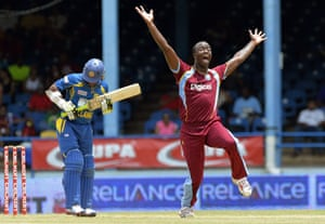 West Indies cricketer Kemar Roach (R) celebrates dismissing Sri Lankan batsman Ajantha Mendis (L) during the fifth match of the Tri-Nation series between Sri Lanka and West Indies at the Queen's Park Oval stadium in Port of Spain.  Sri Lanka resume batting in the 45-overs-a-side game.