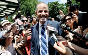 The heat is on: Eliot Spitzer (C), the former Governor of New York State who left office five years ago following a prostitution scandal, smiles as he is surrounded by media after his announcement that he is running for New York City comptroller in New York. Spitzer made the surprise announcement and needs to gather 3,750 signatures by 11 July to get on the ballot. Photograph: Justin Lane/EPA