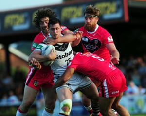 Widnes Vikings' Alex Gerrard is tackled by Wakefield Wildcats' Kyle Amor (left), Danny Kirmond and Paul Aiton (right) during the Super League match at Belle Vue, Wakefield, England.