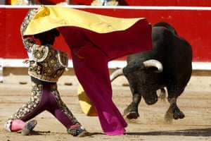 Spanish bullfighter Manuel Escribano fights with his first bull during the second Sanfermines bullfighting, in Pamplona, northern Spain. The festival commemorates St. Fermin, Pamplona's patron saint.
