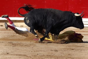 But sometimes bull wins: Spanish bullfighter Joselillo is run over by his first bull during the second Sanfermines bullfighting, in Pamplona. Photograph: Javier Lizon/EPA
