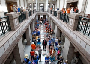 Members of the public wait in line to sign up for an opportunity to speak at a senate hearing to be conducted on a proposed abortion bill in Austin, Texas.