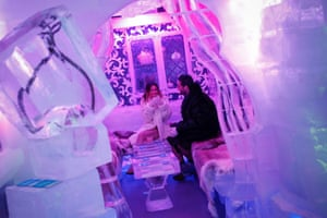 A couple sits inside the Minus5 ice bar in New York. The ice bar is made from 100% pure Canadian ice and is named for its constant minus five degrees (twenty-three degrees Fahrenheit) temperature. Photograph: Shannon Stapleton/Reuters