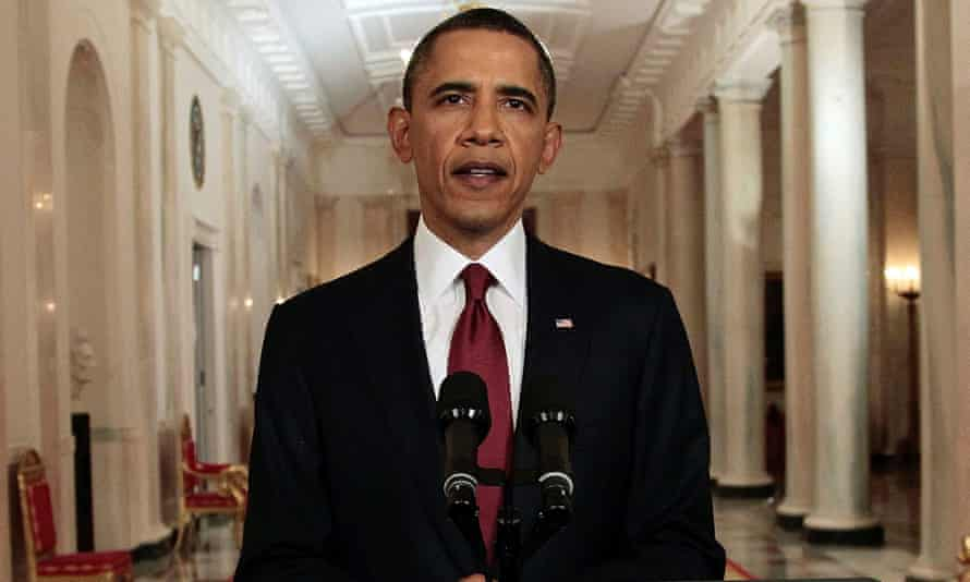 President Barack Obama reads his statement to photographers after making a televised statement on the death of Osama Bin Laden.