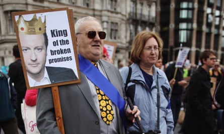 A blind man joins other protesters on a march against government cuts to disability living allowance