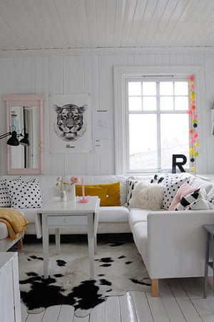 homes - norway house: white room with white sofa and animal skin rug