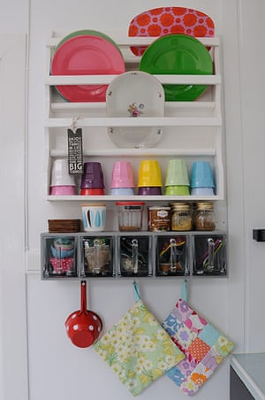 homes - norway house: white wall with white shelves and multi-coloured plates and cups