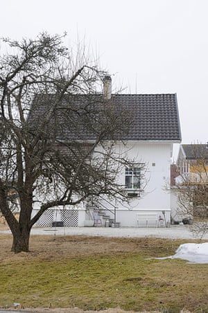 homes - norway house: white house with tree and grass