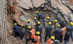 Disaster Response Force personnel search for bodies in the rubble of the City Light Hotel in Secunderabad, India, the day after the two-storey building collapsed, killing at least 13 people and injuring 17 others.