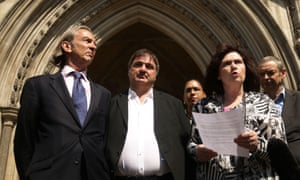 Barry George, centre, stands outside the Royal Courts of Justice, London, where he lost his legal battle for compensation as a victim of a miscarriage of justice in the Court of Appeal. He spent eight years in prison after being wrongly convicted of the murder of TV presenter Jill Dando.