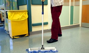 Hospital cleaner mopping the floor