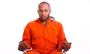 Yasiin Bey being force fed to highlight the force feeding of Guantánamo Bay prisoners.