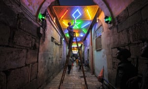 A Palestinian man decorates close to the entrance of the Al-Aqsa mosque compound in the old city of Jerusalem as people prepare for the upcoming Muslim holy fasting month of Ramadan.