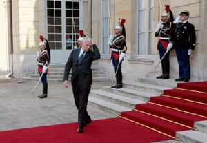 Do I look good in this? French Prime Minister Jean-Marc Ayrault (C) fixes his hair prior to arrival of Finnish President at the Hotel Matignon in Paris. Photograph: Jacques Demarthon/AFP/Getty Images