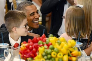 U.S. President Barack Obama smiles with Makenna Hurd (front R) of Mascot, Tennessee, and Noah Koch (L) of Waterville, Maine, during the second annual 'Kids' State Dinner', in the East Room of the White House in Washington DC. The 'State Dinner' features a selection of winning recipes and recognizes fifty-four winners representing all US states, three territories and the District of Columbia.