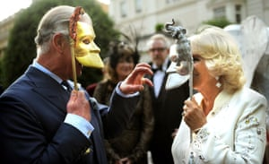 Prince Charles, Prince of Wales and Camilla, Duchess of Cornwall pose with masks as they host a reception for the Elephant Family, a charity working to save the Asian Elephant from extinction in the wild, at Clarence House in London, England.