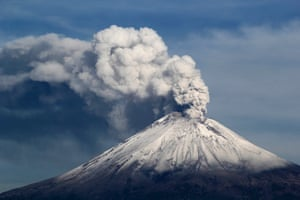The snow-covered Popocatepetl volcano spews a cloud of steam into the air in Puebla. Mexican authorities raised the alert level for the Popocatepetl volcano after an increased level of explosive activity belched ash over Mexico City and pushed international airlines to suspend flights. Photograph: Stringer/Mexico/Reuters