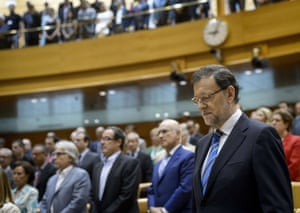 Spanish Prime Minister and PP (Popular Party) leader Mariano Rajoy waits prior to appearing before a special session over allegations that he received illegal payments from his party at the Parliament in Madrid on August 1, 2013.