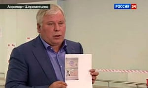 Anatoly Kucherena, Edward Snowden's lawyer, shows a copy of a temporary document allowing