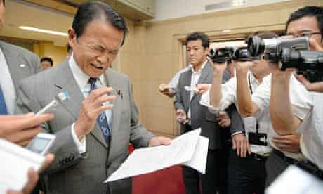 Taro Aso reads a statement to retract his remarks about Nazi Germany