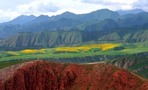 Rainbow mountains: The Danxia landform (bottom) and fields of rape blossoms in Qilian County