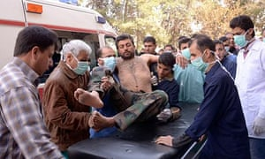 A Syrian army soldier is taken to hospital after an alleged chemical weapons attack near Aleppo