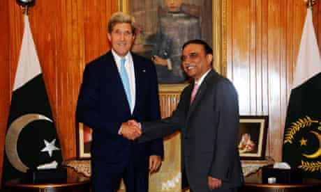 John Kerry shakes hands with the president of Pakistan, Asif Ali Zardari, in Islamabad