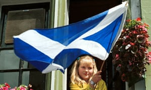 A girl waves the Scottish flag