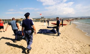 The bodies of the six drowned Eygptians were laid out on a popular beach in Catania
