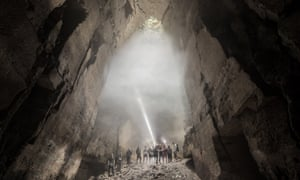 """Explorers in the """"cathedral"""" chamber of Box Freestone Mine in Box, Wiltshire"""