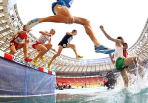 Athletes compete in the Men's 3000 metres steeplechase heats during the IAAF World Athletics Championships in Moscow