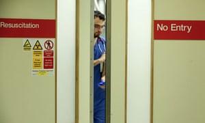 medical staff behind doors