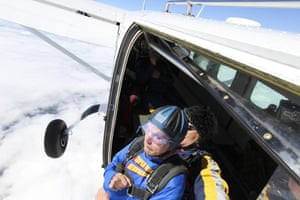 Harry Facer, who suffers from with Motor Neurone Disease completes a sponsored skydive in Peterborough