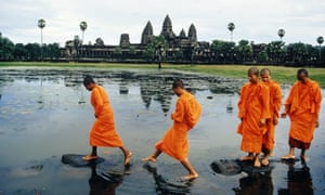 Buddhist Monks Crossing Lake on Rocks