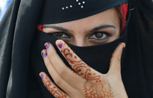 A Muslim Khawateen Markaz activist looks on as she participates in a protest in Srinagar