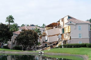 Sinkhole: Clermont, Florida: A building sits partially collapsed over a sinkhole at S
