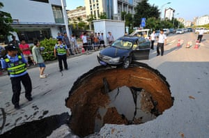 Sinkhole: Nanjing, China: A driver had a lucky escape when he narrowly managed to avo