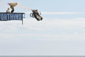 Australian competitor Amos Gill pushes his wheeled vehicle off the diving platform during the Worthing International Birdman event. The annual flying competition took place over the weekend, with both serious and fun flyers in colourful costumes who launch themselves from the pier.