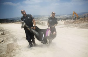 An Ultra-Orthodox Jewish man is arrested by Israeli policemen in Ramat Beit Shemesh West of Jerusalem, after dozens of Haredim protest against desecration of ancient graves were discovered at a new housing construction site. Some 14 Ultra-orthodox Jews were arrested. Photograph: Menahem Kahana/AFP/Getty Images