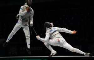 Italy's Andrea Baldini (L) fights against Race Imboden (R) of the US during the final round of the men's team foil competition at the 2013 World Fencing Championships in Budapest. Photograph: Attila Kisbenedek/AFP/Getty Images