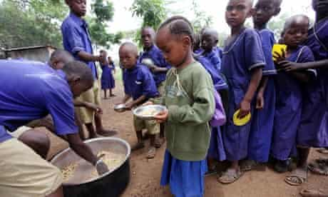 Children queue for lunch at Tanzanian school