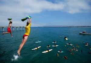 Junior lifeguards jump off Ocean Beach pier to help raise money for their Junior Lifeguard Organization at Ocean Beach, San Diego, United States. Photograph: Mike Blake/Reuters